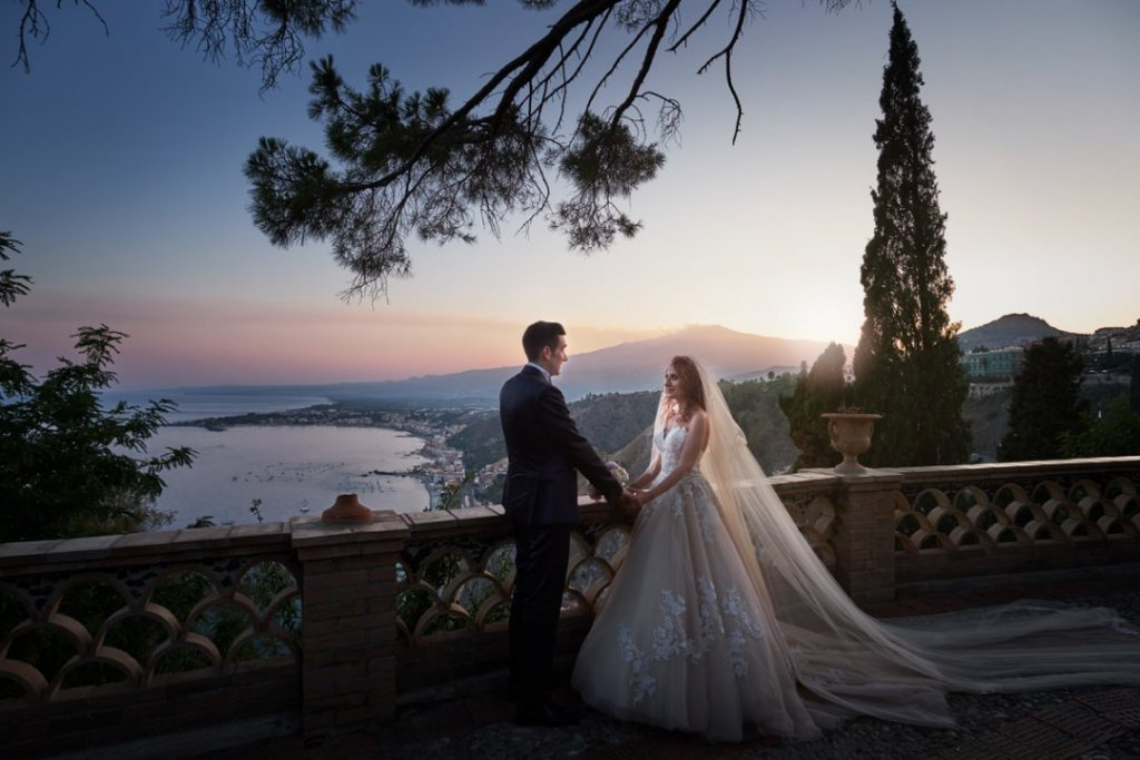 sunset taormina with etna landscape during wedding photographers Fabio Grasso PH after ceremony in varo church