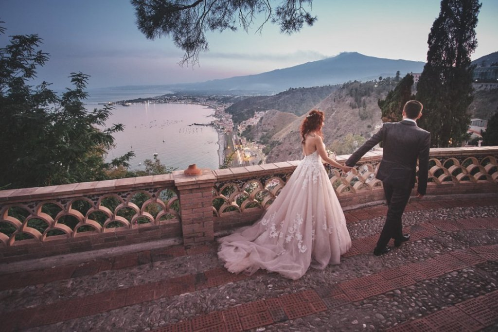after ceremony in varò church in taormina bride and groom intimate wedding pictures destination public garden venue