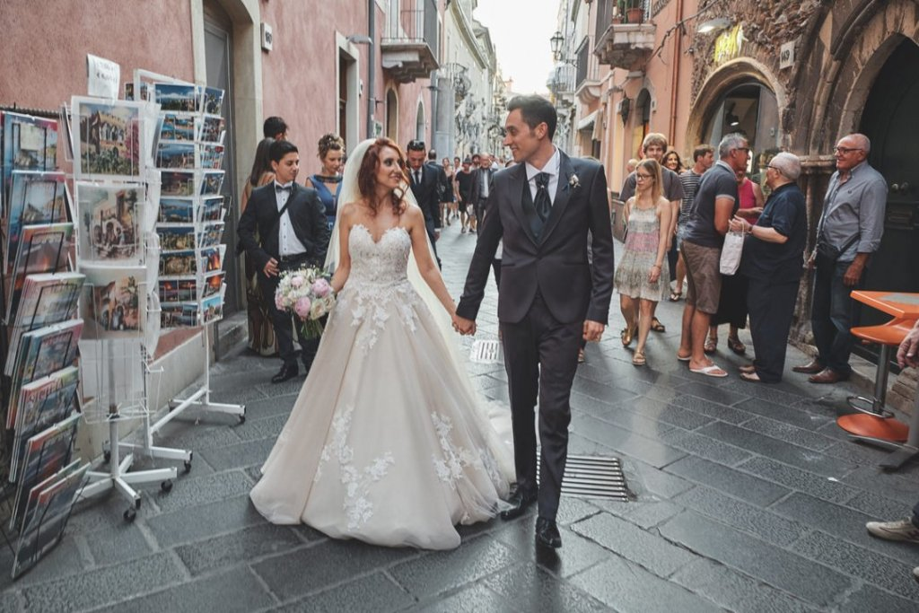 bride and groom after ceremony in varo church in corso umberto taormina