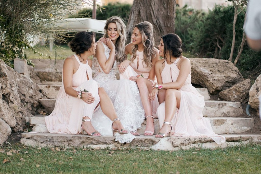 bride and bridesmaids share emotions after to get married in sicily
