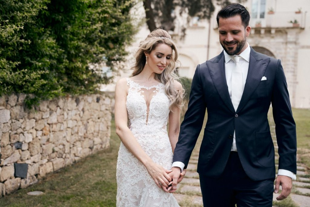 bride and groom walking in castello camemi in sicily destination wedding