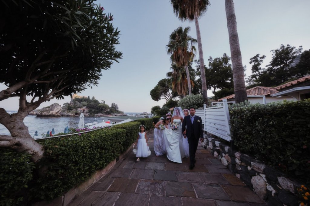 bride and her father at the isola bella at la plage resort in taormina