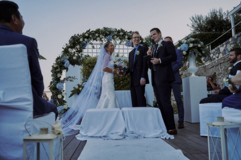 bride and groom at the altar in la plage resort during their wedding ceremony in taormina